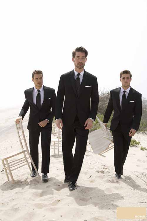 Groomsmen wearing suits from men's clothing store John's Tuxedos in New Orleans, LA